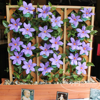 Clematis Cupcake Trellis! My husband and I custom built this trellis-cupcake stand for a friend's baby shower. Each cupcake was adorned with a gumpaste purple...