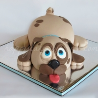 Puppy Dog Cake!  I made this cake for a little boy's 1st birthday. My client sent me a picture of a similar, yet simpler cake to take inspiration from...