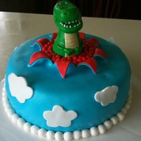 Rex I was given a photo of a cake a lady wished to have done. This is not my design.Really enjoyed making the dino on top! Red velvet cake with...