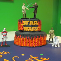 Star Wars  Star Wars lettering, light sabers and stars on cake are made of fondant. Cake is red velvet covered in black buttercream with buttercream...