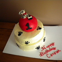 One Year Puppy Cake   2 tiers with buttercream a puppy that I hand sculpted sitting on a ball cake.