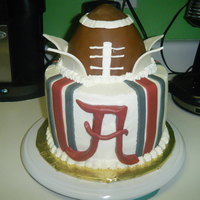 Alabama Football Made from scratch Strawberry cake with Cream cheese icing. Colored stripes and letter A are made of Fondant. The football is made of rice...