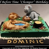 "Land Before Time - Chomper - Fondant Cake This ""Chomper"" Land Before Time fondant cake has a rice krispy treat dinosaur, and surrounding rocks."