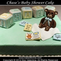 Baby Block Baby Shower Cake Baby shower cake. The baby blocks and bear are made out of rice krispy treat covered in fondant. The books are made out of fondant.