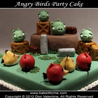 Angry Birds Fondant Cake Angry birds cake. The angry birds, pigs, crates, and other items are rice krispy treat covered in fondant.