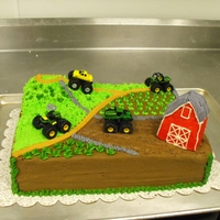 Tractor Cake Chocolate sheet cake with buttercream frosting and decoration, plastic tractors provided by the buyers.