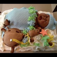 Cake Made For A Baby Shower The Baby And Giraffe Are Sculpted Cake On Top Of A Sheet Cake Cake made for a Baby Shower. The baby and giraffe are sculpted cake on top of a sheet cake.