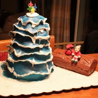 Christmas Tree And Log All edible covered in Fondant. Fondant Santa. Buttercream Log