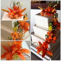 Orange Lilies And Roses GP flowers on a fondant covered WASC wedding cake. The Bride's favor color is orange and her favorite flower is the lily. The Groom&#...
