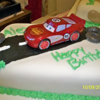 Lightening Mcqueen Cake I made this for the son of a friend of mine...he was turning 5 and requested a Lightening McQueen cake. I had mae a color flow of...