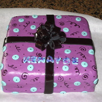 Funky Girly Gift Box Cake For a thirteen year-old girl. Fondant, gum paste bow, painted squigglies and spirals.