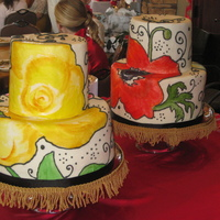 Lily And Poppy Wedding Cakes Bride and groom wedding cakes with flowers representing loved ones that had passed on. Flowers are hand-painted.