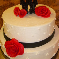 Black And White Wedding Cake Weddig cake for 50 ppl. SMB with black fondant band and red fondant flowers.