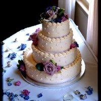 White Wedding Cake. Almond cake with vanilla bean pastry cream and raspberry filling. SMB icing.