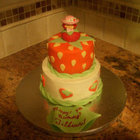 Strawberry Shortcake   Top tier is MMF with SS figurine. Bottom tier is SMB with fondant decorations.