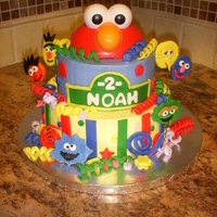 Sesame Street Cake   SMB with fondant decorations. Elmo topper is a toy, all the other faces are fondant.