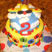 Curious George Birthday Cake   SMB with fondant decorations. I made the plane out of fondant, but the monkey was a candle figurine.