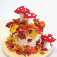 "Autumn Leaves & toadstools made out of fondant with a little gum tragacanth added. This cake is very small, only a 4"" round."