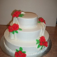 3 Tier Round Wedding Cake With Fondant Roses This 3 tier round wedding cake was covered in BC with MMF swags and roses. I left space on the top tier for the cake topper.