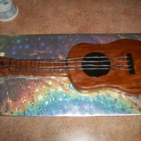 Ukelele Cake This cake was made to look like clients ukelele. Covered in MMF, twizzlers pull-n-peel used as strings.