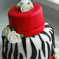 Little Zebra Stripe Cake Just a little cake I made for a charity auction to benefit kids in Rwanda. I thought it turned out really cute. :)