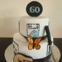 60Th Birthday Cake This cake had quite specific requests for it. A guitar, hockey stick, shell, butterfly and stamps