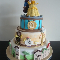 Beauty And The Beast Birthday Cake Client came to me with a photo of a cake she wanted made for her daughters 21st. Cake was a wedding cake but she wanted it as a much...