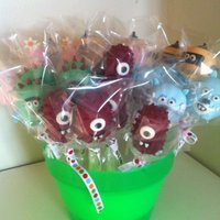 Yo Gabba Gabba Cake Pops Chocolate covered cake pops with fondant details.