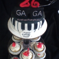 "Lady Gaga Theme Cake Lady GaGa Theme Cake. Sunglasses with gemstones sit on a piano cake. Matching ""meat rags"" cupcakes which were inspired by her..."