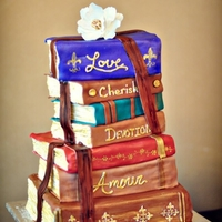 Romantic Stacked Books Wedding Cake This cake was soooo much fun! The bride is an English teacher, and the groom an author, so their whole theme was books and reading! The...