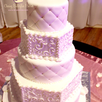 All White 5 Tier Wedding Cake With Quilting Detail And Hand Piped Scroll Work All white 5 tier wedding cake with quilting detail and hand piped scroll work