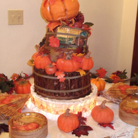Fall (Autumn) Wedding Wood made from graham crackers covered in chocolate. Pumpkins and apples are rice krispie treats covered in chocolate. Large pumpkin bottom...