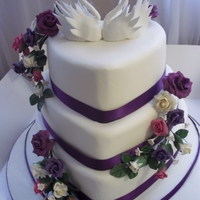 Heart Shaped Wedding Cake  This is the first tiered cake I have made after a disaster that collapsed in transit. Thanks to all the lovely CC members who gave me...