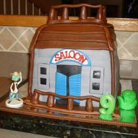 Rango Saloon Cake 8 inch square cakes decorated in fondant to look like a western saloon. It was really hard for me to come up with an idea for this cake......