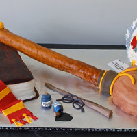 Harry Potter 3D Cake This cake was HUGE. It was 4 ft long and 2 feet wide. The broom is cake w/ a rice krispie treat (and pvc pipe) broom handle, all covered in...