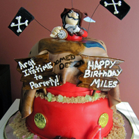 Captain Hook Cake This is an eight inch and a six inch cake. Captain Hook was handmade out of fondant, as were all the other decorations (except the coins,...