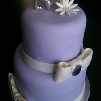 "Purple & Bows 8"" and 6"" round cakes, covered and decorated in fondant :)"
