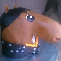 Biker Horse The body of the horse is butter cake and the head is chocolate. All buttercream icing covered and decorated in fondant. Inspired by a biker...
