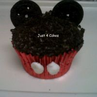 Mickey Mouse Cupcake Made these for my son's 1st bday to give to the kids at my daycare( I run a daycare at my home) :)