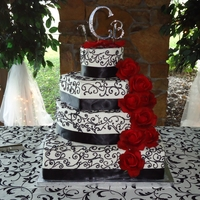 Ms. Maria black , white and red themed cake