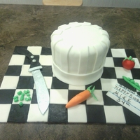 Chef Hat I made this cake with two 7 inch rounds all veggies are fondant with a little tylose powder the board is also fondant covered...