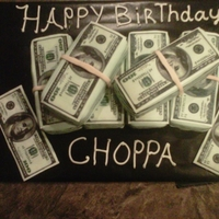 Money Stcak Cake I used a 9x13 cake pan two of them and used a 100 dollar bill image as a template and cut into loaves each pan made 3 i used a 2 dabs of...
