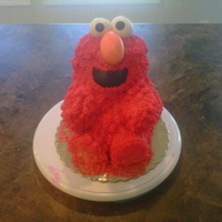 Elmo Cake I used the teddy bear cake pan and tip 233 for the fur nose and eyes are fondant and his feet is cupcakes
