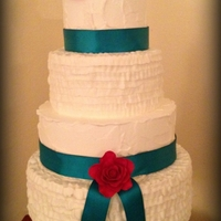 Rustic Ruffle Wedding Cake Frosted in Buttercream; Roses are Gumpaste; Ribbon is Satin. TYFL!