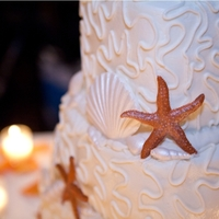 Beach Wedding Coral-like cornelli lace, gumpaste starfish and shells.