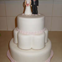 Bride And Groom First attempt at wedding style cake. Done for my child's pre school who were having a wedding party!!