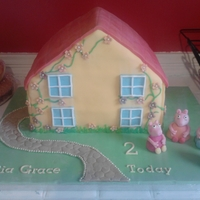 Peppa Pigs House Peppa pig house, all peppas family are made from fondant aswell, cake was chocolate and vanilla