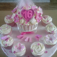 16Th Giant Cupcake And Small Cupcakes Giant cupcake case is white chocolate with a white chocolate filling