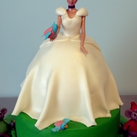 "Cinderella Cake This cake was for a the cutest little girl! She wanted Cinderella in her ""wedding dress"". So that's what we did! It was a..."