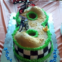 Number 8 Dirtbike Racetrack The birthday boy turned 8 and his mom said he wanted a dirt bike themed cake, so I incorporated his age into the cake.